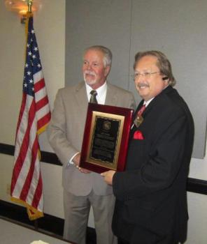 Executive Director J.D. Hobbie was presented with a plaque recognizing  his hard work lobbying with the Alabama Legislature.