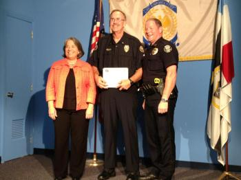 Lt. Gene Sasscer pictured with Knoxville Mayor Madeline Rogero and Knoxville Police Chief David Rausch